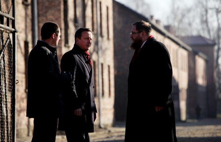 minister of war: AUSCHWITZ, POLAND - DECEMBER 10, 2014: British Prime Minister David Cameron during the visit in the concentration camp Auschwitz -- Birkenau. Poland