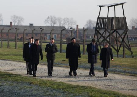 auschwitz memorial: AUSCHWITZ, POLAND - DECEMBER 10, 2014: British Prime Minister David Cameron during the visit in the concentration camp Auschwitz -- Birkenau. Poland