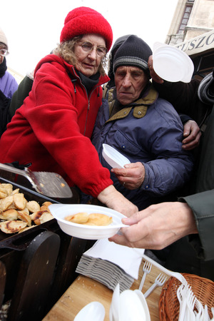 KRAKOW, POLAND - DECEMBER 19, 2010;  Christmas Eve for poor and homeless on the Central Market in Cracow. Every year the group Kosciuszko prepares the greatest eve in the open air in Poland.