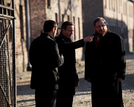 birkenau: AUSCWITZ, POLAND - DECEMBER 10, 2014: British Prime Minister David Cameron during the visit in the concentration camp Auschwitz -- Birkenau. Poland Editorial