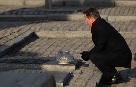 minister of war: AUSCWITZ, POLAND - DECEMBER 10, 2014: British Prime Minister David Cameron during the visit in the concentration camp Auschwitz -- Birkenau. Poland Editorial