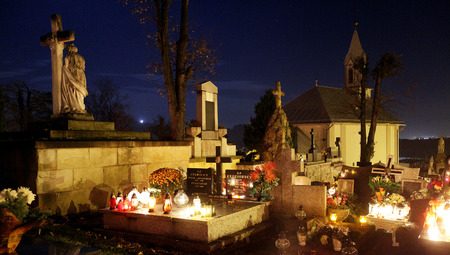 all saints day: Candle flames illuminating  cemetery during All Saints Day Stock Photo