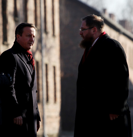 birkenau: AUSCWITZ, POLAND - DECEMBER 10, 2014: British Prime Minister David Cameron during the visit in the  concentration camp Auschwitz -- Birkenau. Poland