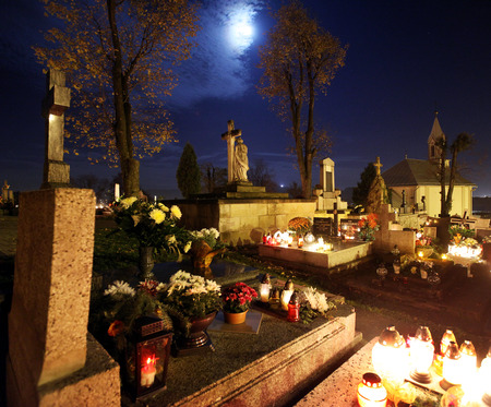 Candle flames illuminating  cemetery during All Saints Day Stock Photo
