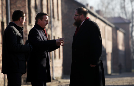concentration camp: AUSCWITZ, POLAND - DECEMBER 10, 2014: British Prime Minister David Cameron during the visit in the  concentration camp Auschwitz -- Birkenau. Poland
