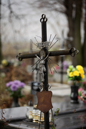 ascetic: Old iron cross in cemetery