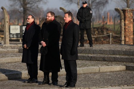 AUSCWITZ, POLAND - DECEMBER 10, 2014: British Prime Minister David Cameron during the visit in the Nazi concentration camp Auschwitz -- Birkenau. Poland
