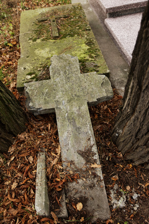 graves: Old cross on one of the graves