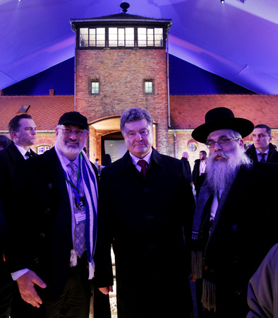 auschwitz: AUSCHWITZ, POLAND - JANUARY 27, 2015: 70th anniversary of the liberation of German concentraction and extermination camp Auschwitz