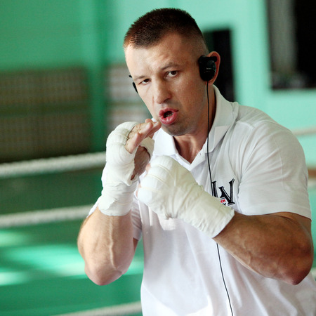 the heavyweight: GILOWICE, POLAND - OCT 30, 2014: Tomasz Adamek Polish professional heavyweight boxer during the training before the following boxing-fight. He is a former WBC Light Heavyweight Champion and former IBF, IBO & The Ring Cruiserweight Champion, and IBF North