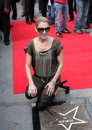 fame: KRAKOW, POLAND - JUNE 28: Celine Dion in Krakow where she was honored with the first star on the Krakow Walk of Fame, Krakow, Poland on June 28, 2008.