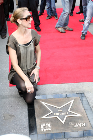 honored: KRAKOW, POLAND - JUNE 28: Celine Dion in Krakow where she was honored with the first star on the Krakow Walk of Fame, Krakow, Poland on June 28, 2008.