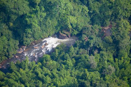 aerial view of waterfall at plentifully  tropical rain forest in Thiland