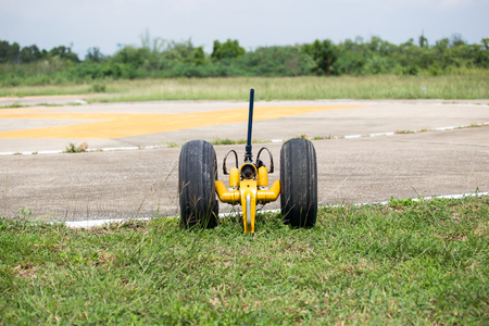 helicopter pad: hydraulic wheel  for move helicopter Stock Photo
