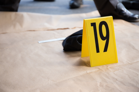 collectives: evidence tag number  for photograph in  crime scene