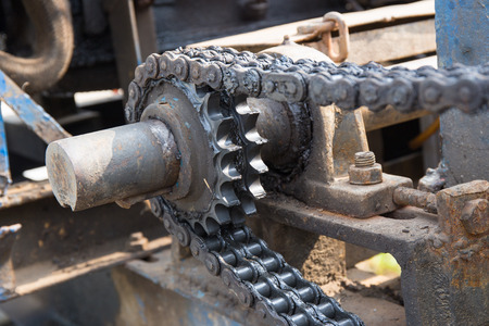 pile engine: dirty chain and cogwheel Stock Photo