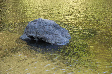 klong: single rock in water texture Stock Photo