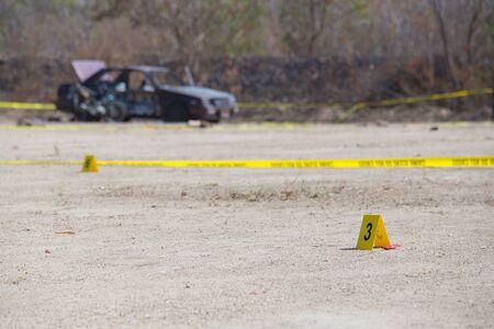 csi: evidence and crime scene tape in car explosion crime scene