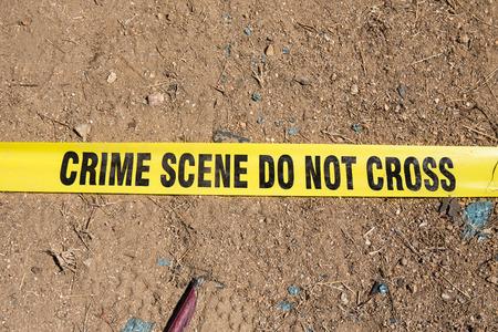 crime scene tape: crime scene tape on ground Stock Photo