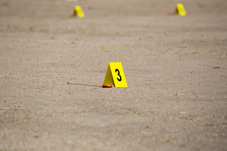 csi: yellow evidence number tag in  crime scene Stock Photo