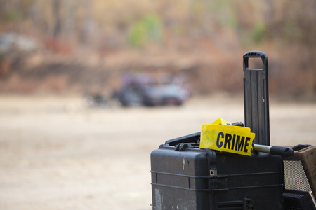 crime scene tape: crime scene tape on tool box and car bomb background