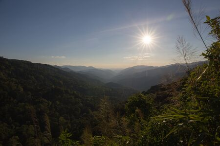 plentifully: sunshine to range of mountains at tropical rain forest in Thailand Stock Photo