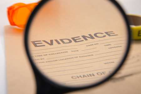 evidence bag: magnifying glass focus on evidence bag