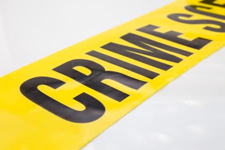 crime scene tape: word crime on crime scene tape on white background