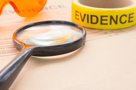 evidence bag: magnifying glass with forensic tool for crime scene investigation