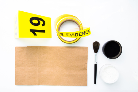 background csi: latent fingerprint search tool in crime scene isolated on white background