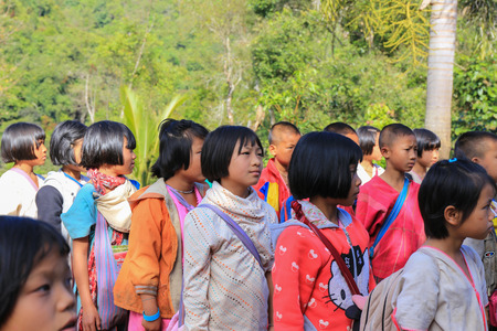 uneducated: Tak, Thailand-Jan 16: Karen children stand in line at border primary school on Jan 16, 2015 in Tha Song Yang, Tak, Thailand. School located in mountain near Thailand-Myanmar border for help and study Ethnics children Editorial