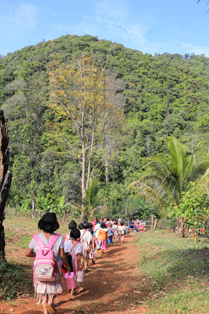 uneducated: Tak, Thailand-Jan 16: Karen children back home after class from  border primary school on Jan 16, 2015 in Tha Song Yang, Tak, Thailand. School located in mountain near Thailand-Myanmar border for help and study Ethnics children