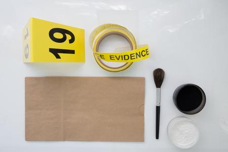 evidence bag: blank paper evidence bag with latent fingerprint tool on white background Stock Photo