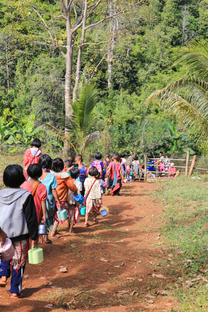 Tak, Thailand-Jan 16: Karen children back home after class from  border primary scool on Jan 16, 2015 in Tha Song Yang, Tak, Thailand. The School located in mountain near Thailand-Myanmar border for help and study Ethnics children