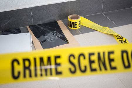 latent: latent footprint evidence with blurred crime scene tape