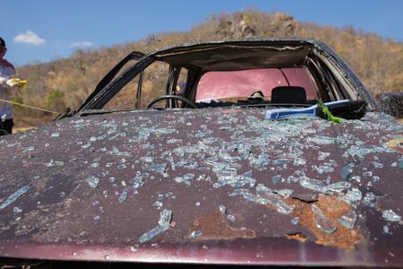 crime scene investigation: Glass from windshield on bonnet from car bomb in crime scene investigation