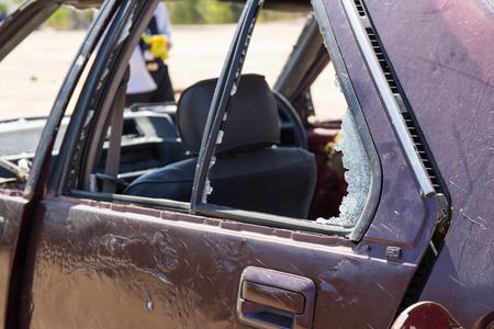 crime scene investigation: broken car window from car bomb in crime scene investigation