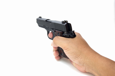 gunsight: hand hold and aim automatic pistol isolated on white background Stock Photo