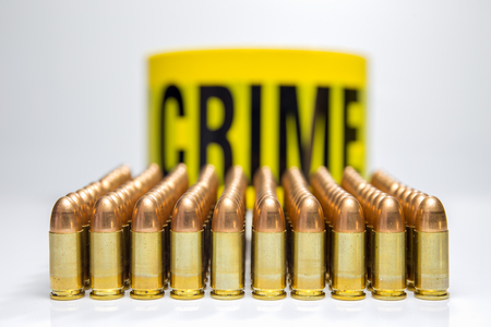 row of bullet and word crime background Stock Photo