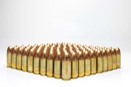 full jacket bullet: row of 9mm bullets isolated