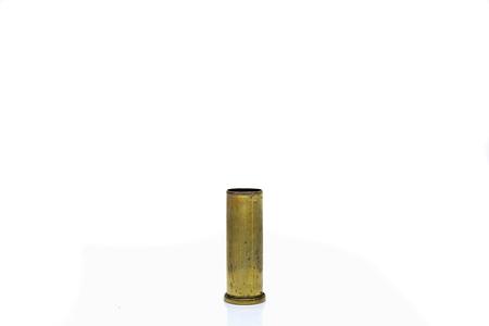 csi: single brass bullet case isolated on white background Stock Photo