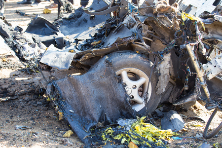 wrecked: car wrecked from car bomb in crime scene