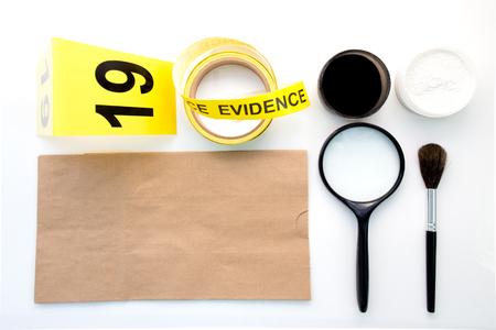 latent: magnifying glass brush evidence marker for detection of latent fingerprint  tool in crime scene isolated on white background Stock Photo