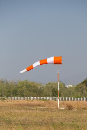 reflective: orange white reflective windsock at parachute drop zone Stock Photo