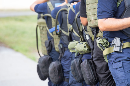 tactical: law enforcement training team with tactical equipment and tactical movement in academy Stock Photo