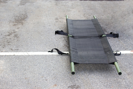 single light portable stretcher for medical evacuation or medevac for law enforcment tactical team isolated on road 版權商用圖片