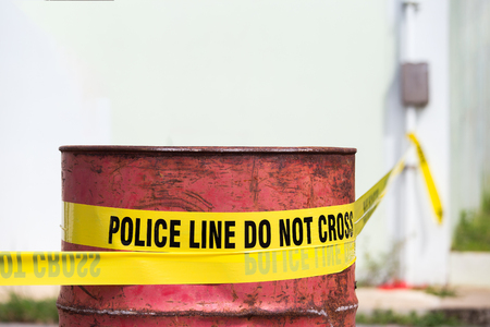 police line do no cross with red barrel to protection crime scene  with copy space
