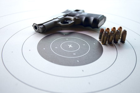 gun shooting target with pistol and bullet and copy space Stock Photo