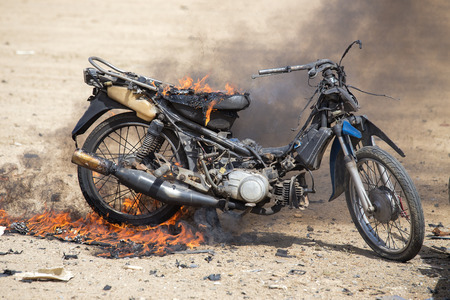 flame burned motorcycle from explosive in forensic law enforcement training
