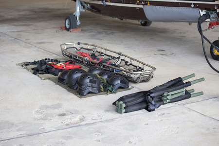 medical evacuation equipment for searh and rescue team arrange on ground before mission with helicopter background